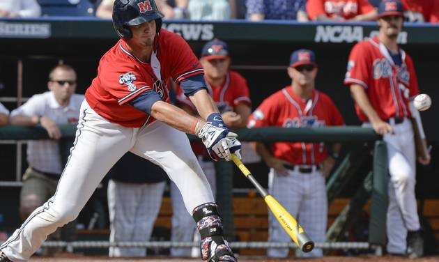 Mississippi infielder John Gatlin (36) hits a single in the ninth inning against Texas Tech that scored teammate Aaron Greenwood in an NCAA baseball College World Series elimination game in Omaha, Neb., Tuesday, June 17, 2014. Mississippi won 2-1. (AP Photo/Ted Kirk)