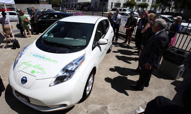 Bay Area city officials look at new electric vehicles during a press conference at the AlcoPark Garage Plaza in Oakland, Calif., Tuesday, July 8, 2014. A group of San Francisco Bay Area cities, counties and water agencies has joined forces for what is being billed as one of the largest single government purchases of all-electric vehicles in the country. (AP Photo/Bay Area News Group, Ray Chavez)