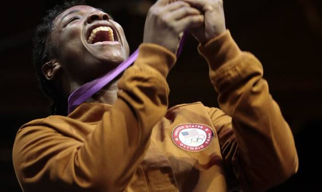 FILE - In this Aug. 9, 2012 file photo, boxing gold medalist Claressa Shields, of the United States, reacts during the medal ceremony at the 2012 Summer Olympics,in London. Unwilling to accept a life of poverty, crime or worse, Shields found her family, her passion and her way out through a small, dark basement gym. (AP Photo/Ivan Sekretarev, File)