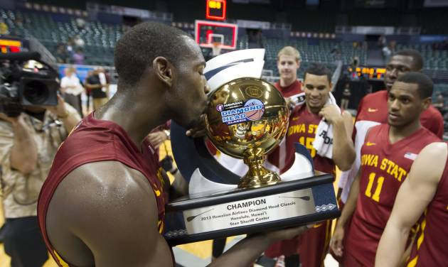 Iowa State forward Dustin Hogue gives the Diamond Head Classic championship trophy a kiss after Iowa State defeated Boise State in an NCAA college basketball game Wednesday, Dec. 25, 2013, in Honolulu. Iowa State won 70-66. (AP Photo/Eugene Tanner)