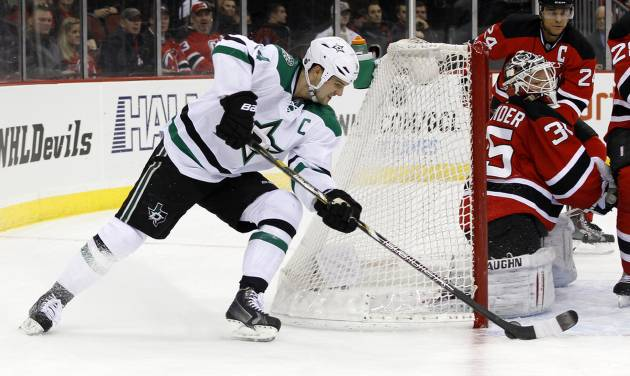 New Jersey Devils goalie Cory Schneider makes a save on a shot by Dallas Stars left wing Jamie Benn during the first period of an NHL hockey game Thursday, Jan. 9, 2014, in Newark, N.J. (AP Photo/Adam Hunger)