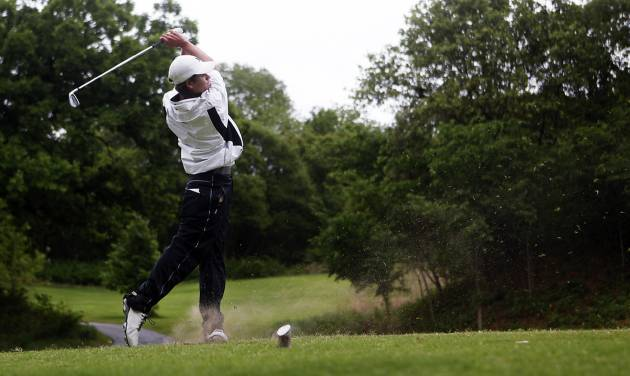 Hayden Wood of Edmond North tees off at the 6A Golf State Championship at Karsten Creek, Monday, May 12, 2014, in Stillwater. Photo by KT King, For The Tulsa World