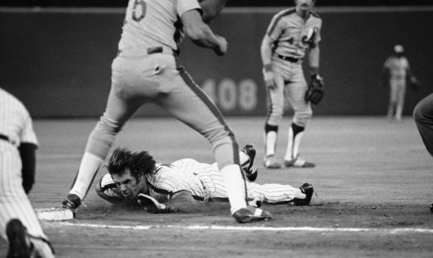 FILE - In this Sept. 8, 1981, file photo, Pete Rose, bottom, dives safely into third on a sacrifice by teammate Gary Matthews during early action against the Montreal Expos in Philadelphia, Pa. If Rose played today, his signature dives wouldn't be much of a novelty. It's become common in the majors for runners to fling their arms out, lead with their faces and hurtle toward bases. (AP Photo/Clem Murray, File)