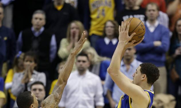 Golden State Warriors' Klay Thompson (11) puts up the game winning shot against Indiana Pacers' George Hill (3) during the second half of an NBA basketball game Tuesday, March 4, 2014, in Indianapolis. Golden State defeated Indiana 98-96. (AP Photo/Darron Cummings)