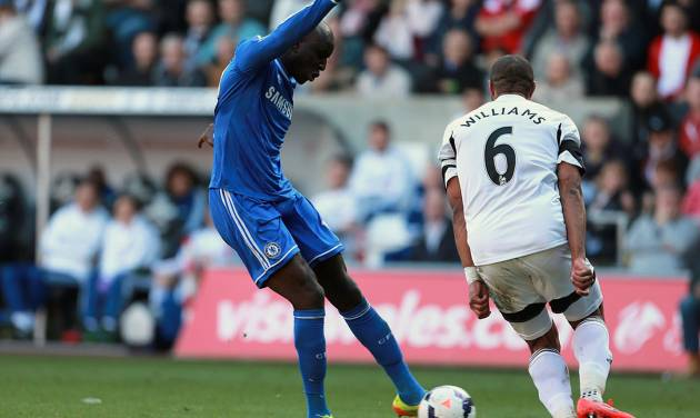 Chelsea's Demba Ba, left, scores his teams opening goal during their English Premier League soccer match against Swansea City at the Liberty Stadium, Swansea, Wales, Sunday, April 13, 2014. (AP Photo/David Davies, PA Wire)    UNITED KINGDOM OUT   -   NO SALES   -   NO ARCHIVES