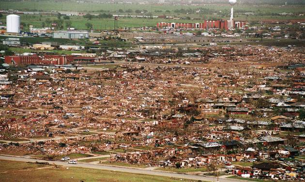 MAY 3, 1999 TORNADO: Tornado damage: Aerial view of Moore looking northeast from near 12th street northeast.  First Baptist Church is at top right.