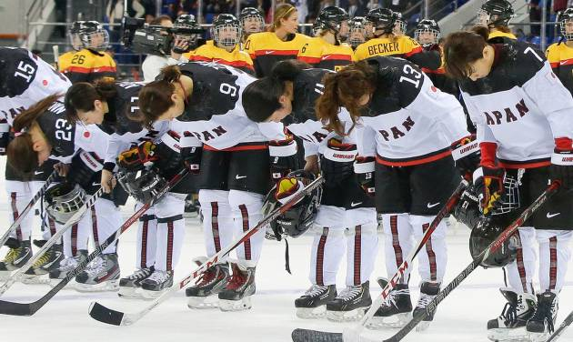 Members of team Japan bow after their 3-2 loss to Germany in the 2014 Winter Olympics women's ice hockey game at Shayba Arena, Tuesday, Feb. 18, 2014, in Sochi, Russia. (AP Photo/Matt Slocum)