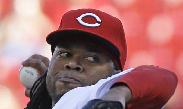 Cincinnati Reds starting pitcher Johnny Cueto throws against the Philadelphia Phillies in the first inning of a baseball game, Friday, June 6, 2014, in Cincinnati. (AP Photo/Al Behrman)