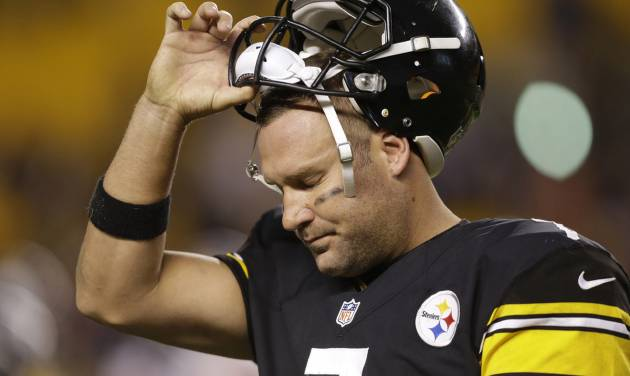 Pittsburgh Steelers quarterback Ben Roethlisberger (7) tugs his helmet off as he leaves the field in the fourth quarter as his team is losing to the Chicago Bears in  an NFL football game in Pittsburgh, Sunday, Sept. 22, 2013. The Steelers lost 40-23. (AP Photo/Gene J. Puskar)