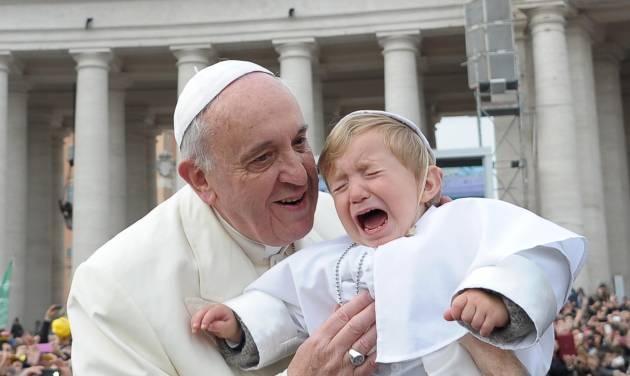 In this picture provided by the Vatican newspaper L'Osservatore Romano, 19-month-old Daniele De Sanctis, dressed up as a pope, is handed to Pope Francis as he is driven through the crowd during his weekly general audience in St. Peter's Square at the Vatican, Wednesday, Feb. 26, 2014. Francis kissed the child as the new must-have Carnival costume made its debut at the pope's general audience Wednesday. During Carnival in Italy, children often go to school and spend their weekends dressed up in pirate, princess — and now pope — costumes. Carnival, also known as mardi gras, marks the period before the church's solemn Lenten season begins. Daniele's mother, Paola Ciabattini, said she dressed her son as a pope in a demonstration of affection towards Pope Francis. (AP Photo/L'Osservatore Romano, ho)