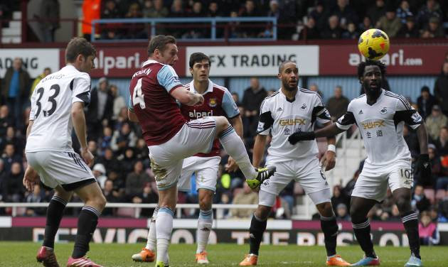 West Ham United's Kevin Nolan, second left, scores his second goal against Swansea City during their English Premier League soccer match at Upton Park, London, Saturday, Feb. 1, 2014. (AP Photo/Sang Tan)