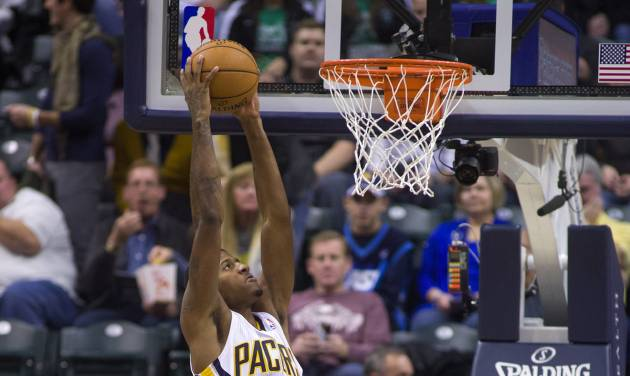 Indiana Pacers' Paul George (24) takes the ball to the basket for a slam dunk during the first half of an NBA basketball game against the Dallas Mavericks in Indianapolis, Friday, Nov. 16, 2012. (AP Photo/Doug McSchooler)