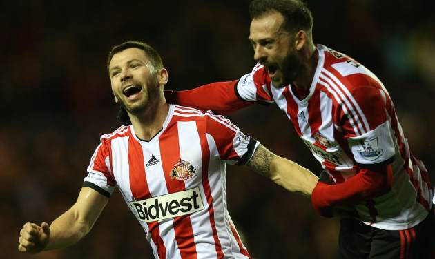 Sunderland's captain Phil Bardsley, left, celebrates his goal   with his teammates during their English League Cup semifinal first leg soccer match against Manchester United at the Stadium of Light, Sunderland, England, Tuesday, Jan. 7, 2014. (AP Photo/Scott Heppell)
