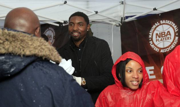 NBA Player Roger Mason, Jr., joins volunteers as they distribute turkeys in Harlem as Part of Association's Nationwide Season of Feeding Tuesday, Nov. 22, 2011, in New York. After filing two separate antitrust lawsuits against the league in different states, NBA players are consolidating their efforts and have turned to the courts in Minnesota as their chosen venue. (AP Photo/Frank Franklin II)