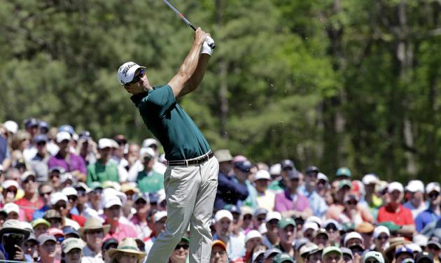 Adam Scott, of Australia, tees off on the 12th hole during the first round of the Masters golf tournament Thursday, April 10, 2014, in Augusta, Ga. (AP Photo/David J. Phillip)