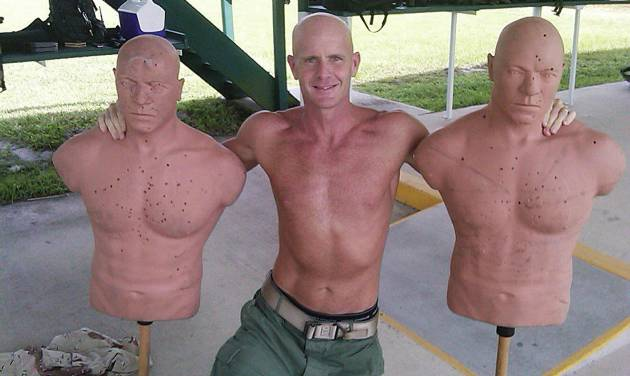 This undated photograph obtained by The Seattle Times shows FBI Special Agent Frederick W. Humphries posing with target dummies following a SWAT practice in an unknown location. The Times says Humphries sent the photograph to friend and Florida socialite Jill Kelley and others, including one of the paper's own reporters, in an email Sept. 9, 2010. (AP Photo/The Seattle Times) MAGS OUT; NO SALES; SEATTLEPI.COM OUT; MANDATORY CREDIT