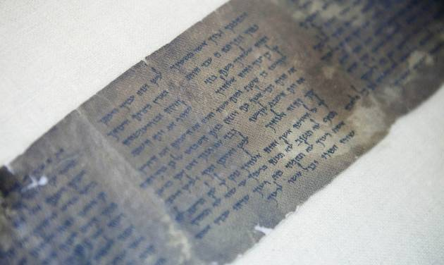 This Friday, May 10, 2013 photo shows the ten commandments written on one of the Dead Sea Scrolls in Jerusalem. Nearly 70 years after the discovery of the world's oldest biblical manuscripts, the Palestinian family who originally sold them to scholars and institutions is now quietly marketing the leftovers - fragments the family says it has kept in a Swiss safe deposit box all these years. (AP Photo/Dan Balilty)