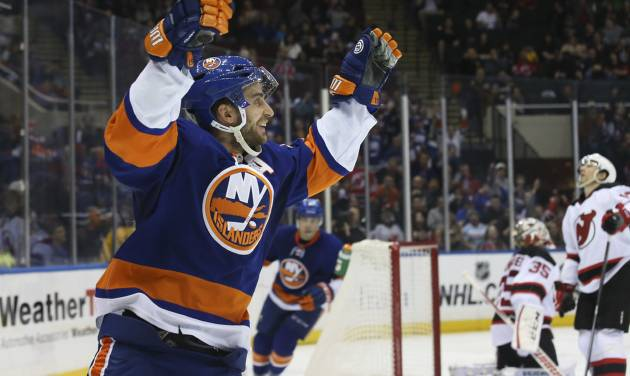 New York Islanders center Frans Nielsen (51) celebrates after scoring in the second period of an NHL hockey game against the New Jersey Devils, Saturday, March 29, 2014, in Uniondale, N.Y. (AP Photo/John Minchillo)