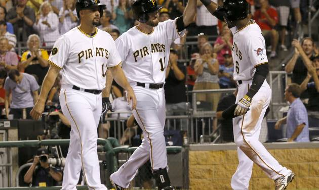 Pittsburgh Pirates' Ike Davis (15) is greeted by teammates Gaby Sanchez, left, and Starling Marte after driving them in with a three-run home run n the eighth inning of the baseball game against the St. Louis Cardinalson Tuesday, Aug. 26, 2014, in Pittsburgh. The Pirates won 5-2. (AP Photo/Keith Srakocic)