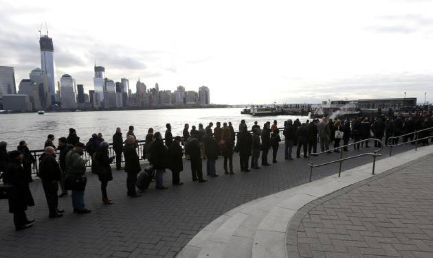 A long line forms at the ferry terminal in Jersey City, N.J., as people commute toward New York City, Monday, Nov. 5, 2012. Flooding caused by Superstorm Sandy has halted mass transportation in the northern New Jersey region with train service to New York completely shutdown. (AP Photo/Julio Cortez)
