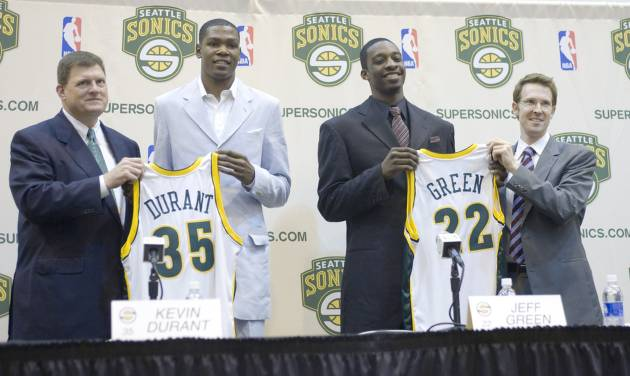 NBA basketball team Seattle SuperSonics draft pick Kevin Durant, second from left, and Jeff Green, second from right, the rights to whom the Sonics acquired in a trade with the Boston Celtics for Ray Allen, are introduced to the news media at the Sonics' practice center in Seattle on Friday, June 29, 2007. At left is owner, chairman Clay Bennett and at right is general manager Sam Presti. (AP Photo/John Froschauer)