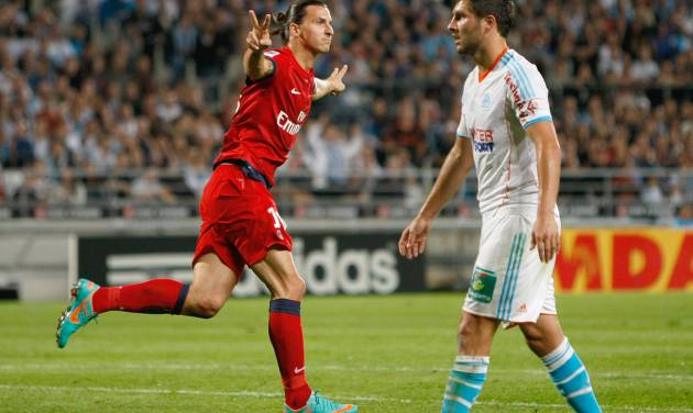 Paris Saint Germain's Swedish forward Zlatan Ibrahimovic, left, reacts after scoring against Marseille, asMarseille's French forward Andre-Pierre Gignac looks on, during their League One soccer match, in Marseille, southern France, Sunday, Oct.7, 2012. (AP Photo/Claude Paris)