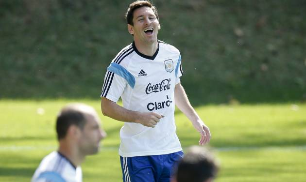 Argentina's Lionel Messi laughs during a training session in Vespasiano, near Belo Horizonte, Brazil, Friday, June 20, 2014.  Argentina plays in group F of the 2014 soccer World Cup. (AP Photo/Victor R. Caivano)
