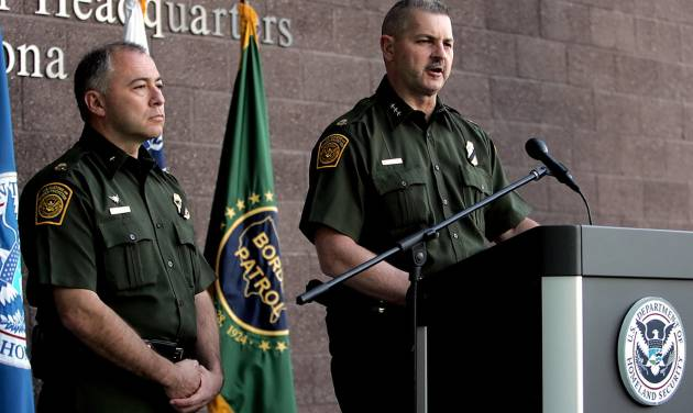 Cmdr. Jeffrey Self, of U.S. Customs and Border Protection, flanked to his left by Acting Chief Patrol Agent Manuel Padilla, releases a statement on Friday, Oct. 5, 2012, at the Tucson Sector Headquarters in Tucson, Ariz. A preliminary investigation has found friendly fire likely was to blame in a shooting that killed U.S. Border Patrol Agent Nicholas J. Ivie and wounded another along the Arizona-Mexico border, the FBI said Friday, shaking up the probe into an incident that re-ignited the political debate over security on the border. (AP Photo/Arizona Daily Star, Mike Christy) ALL LOCAL TV OUT; PAC-12 OUT; MANDATORY CREDIT