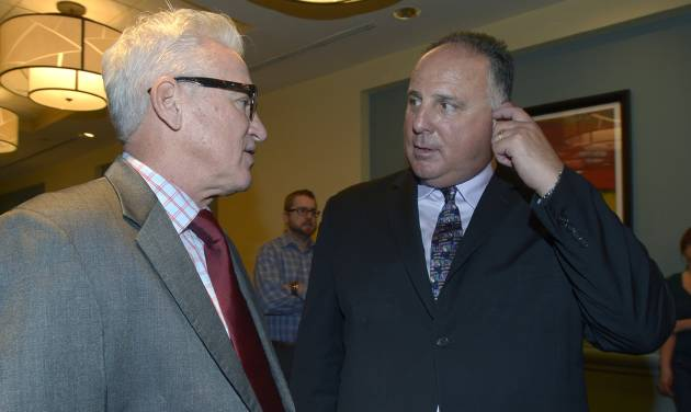 Tampa Bay Rays manager Joe Maddon , left, chats with Los Angeles Angels manager Mike Scioscia at baseball's winter meetings in Lake Buena Vista, Fla., Wednesday, Dec. 11, 2013.(AP Photo/Phelan M. Ebenhack)