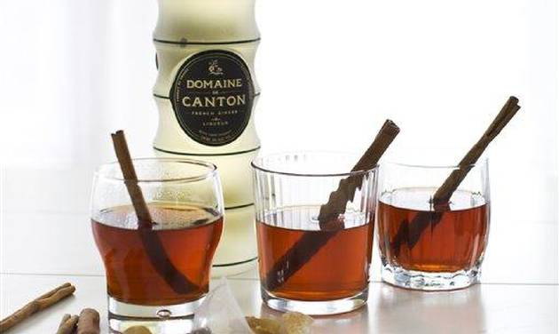 In this image taken on Monday, Oct. 29, 2012, Canton, a French ginger liqueur, served in cinnamon tea is shown in Concord, N.H. (AP Photo/Matthew Mead)