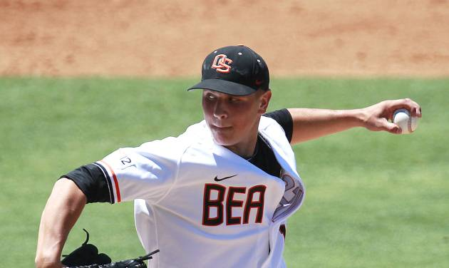 FILE - In this June 1, 2012 file photo, Oregon State pitcher Jace Fry throws in the second inning against Belmont during an NCAA regional tournament college baseball game in Baton Rouge, La. On Sunday, May 4, 2014, Fry allowed one hit in his third complete-game shutout of the season in Oregon State's 5-0 win at California. The victory was OSU's seventh in a row and finished its fourth Pac-12 sweep of the season. Fry has allowed two hits in his last 17 innings. (AP Photo/Gerald Herbert, File)