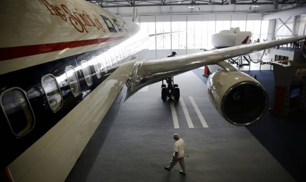 A Boeing 767 airplane sits on display at the grand opening of the new Delta Flight Museum, Tuesday, June 17, 2014, in Atlanta. Delta Air Lines is re-opening a museum at its Atlanta headquarters after extensive renovations in hopes of luring tourists to the company's original aircraft maintenance hangars on the north edge of the world's busiest airport. The 68,000-square-foot museum, housed in hangers that date to the 1940s, traces Delta's history from crop-dusting and air mail service to its first passenger flight from Dallas to Jackson, Mississippi, on June 17, 1929. (AP Photo/David Goldman)