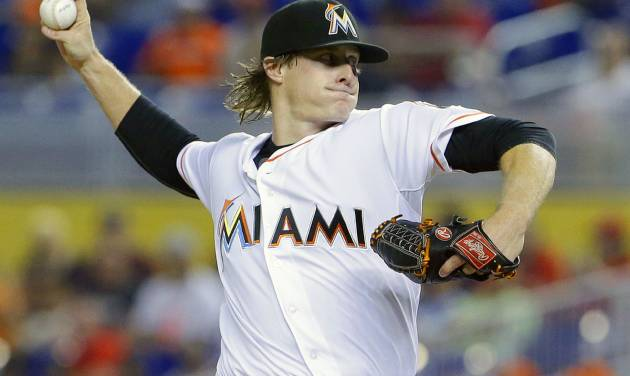 Miami Marlins' Tom Koehler delivers a pitch during the first inning of a baseball game against the Philadelphia Phillies, Wednesday, July 2, 2014 in Miami. (AP Photo/Wilfredo Lee)
