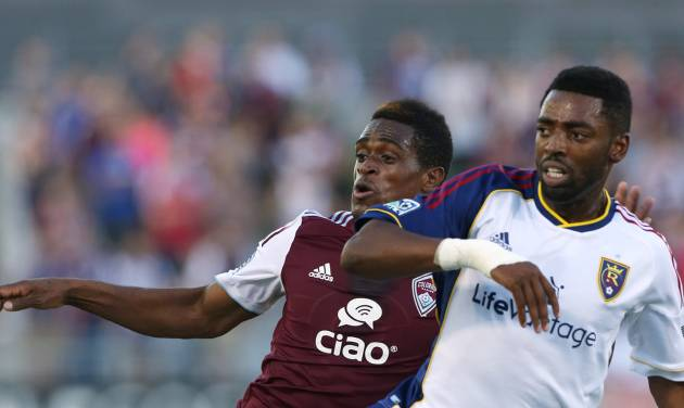 Real Salt Lake defenseman Aaron Maund, right, blocks Colorado Rapids forward Deshorn Brown as they compete for control of ball in the first half of an MLS soccer game in Commerce City, Colo., on Saturday, Aug. 2, 2014. (AP Photo/David Zalubowski)