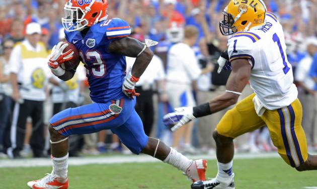 Florida running back Mike Gillislee (23) outruns LSU safety Eric Reid (1) for his second touchdown during the second half of an NCAA college football game, Saturday, Oct. 6, 2012, in Gainesville, Fla. (AP Photo/Phil Sandlin)