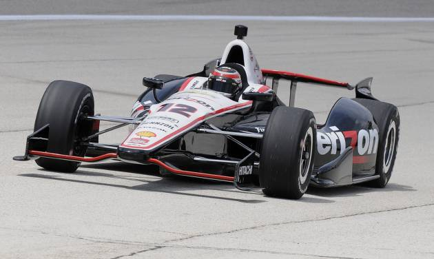Will Power of Australia pulls onto pitt row after taking the pole position during qualifying for the IndyCar auto race at Texas Motor Speedway in Fort Worth, Friday, June 6, 2014. (AP Photo/Larry Papke)