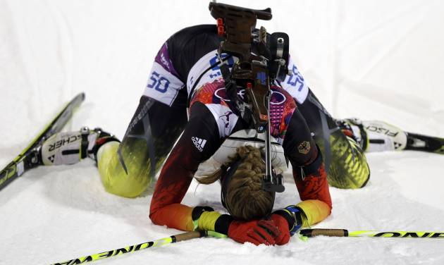 Germany's Franziska Preuss kneels on the snow after completing the women's biathlon 7.5k sprint, at the 2014 Winter Olympics, Sunday, Feb. 9, 2014, in Krasnaya Polyana, Russia. (AP Photo/Kirsty Wigglesworth)
