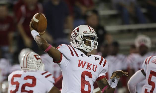Western Kentucky quarterback Kawaun Jakes (6) throws a pass in the first half of an NCAA college football game against Troy in Troy, Ala., Thursday, Oct. 11, 2012. (AP Photo/Dave Martin)