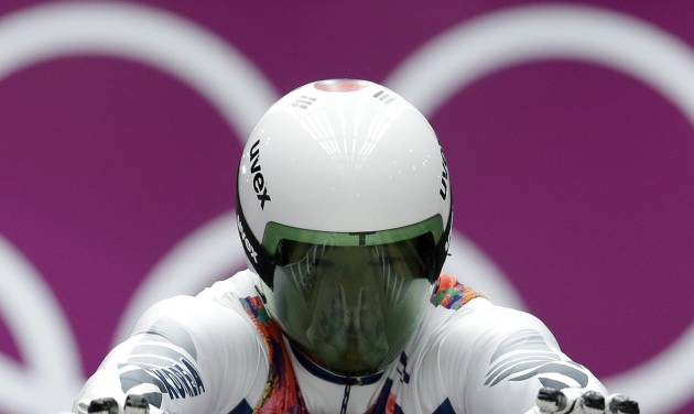 Kim Donghyeon of South Korea starts his second run during the men's singles luge competition at the 2014 Winter Olympics, Saturday, Feb. 8, 2014, in Krasnaya Polyana, Russia. (AP Photo/Natacha Pisarenko)