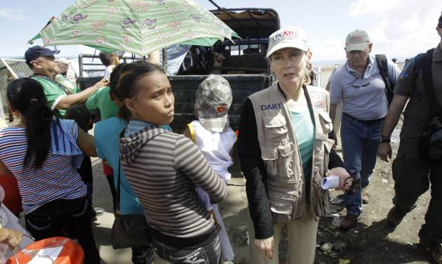 U.S. Agency for International Development (USAID) Assistant Administrator for Humanitarian Assistance, Nancy Lindborg, arrives in a staging area for typhoon victims trying to evacuate the airport in Tacloban, Philippines, Monday, Nov. 18, 2013. Hundreds of thousands of people were displaced by Typhoon Haiyan, which tore across several islands in the eastern Philippines on Nov. 8. (AP Photo/Wally Santana)