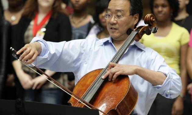 """FILE - In this March 19, 2012 file photo, world-famous cellist Yo-Yo Ma plays in the rotunda of the State of Illinois building, the James R. Thompson Center, in Chicago.   Ma will receive the first Fred Rogers Legacy Award, which is named for the creator and late host of the public television show """"Mister Rogers' Neighborhood."""" Ma was a guest on the show and became friends with Rogers. Ma will give a recital after accepting the award May 23 at a ceremony in the St. Vincent Basilica. (AP Photo/Kiichiro Sato, File)"""