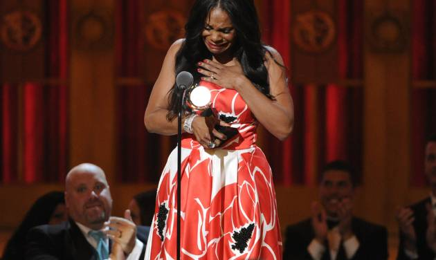 "Audra McDonald accepts the award for best performance by an actress in a leading role in a play for ""Lady Day at Emerson's Bar & Grill"" on stage at the 68th annual Tony Awards at Radio City Music Hall on Sunday, June 8, 2014, in New York. (Photo by Evan Agostini/Invision/AP)"