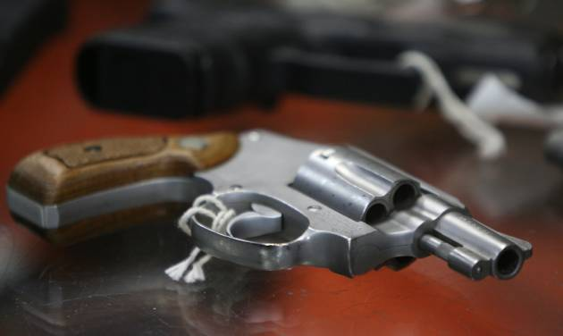 FILE - In this June 26, 2008 file photo, a chrome plated revolver rests on top of a glass display case at John Jovino Co. in New York. A New York county clerk on Thursday, Jan. 3, 2013 justified his refusal to release the names and addresses of handgun permit holders to a newspaper, saying it would give stalkers and thieves a convenient roadmap to target potential victims — and determine whether they have a gun. (AP Photo/Seth Wenig, File)
