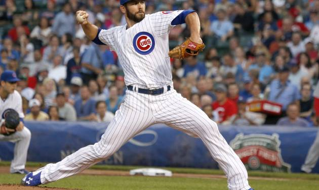 Chicago Cubs starting pitcher Jake Arrieta delivers during the first inning of a baseball game against the Cincinnati Reds on Tuesday, June 24, 2014, in Chicago. (AP Photo/Charles Rex Arbogast)
