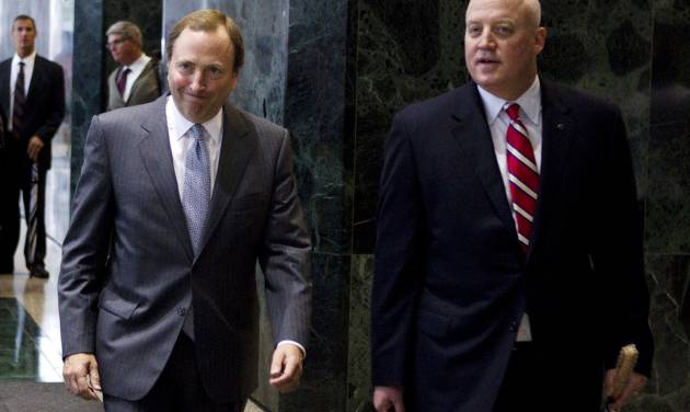 FILE - This Aug. 14, 2012 file photo shows NHL commissioner Gary Bettman, left, and Bill Daly, deputy commissioner and chief legal officer, following collective bargaining talks in Toronto. Daly says the owners and players are both to blame for their failure to reach a new collective bargaining agreement before the Saturday deadline for a work stoppage. Daly wrote in an email to The Associated Press that he hoped both sides would meet before Saturday. (AP Photo/The Canadian Press, Chris Young, File)