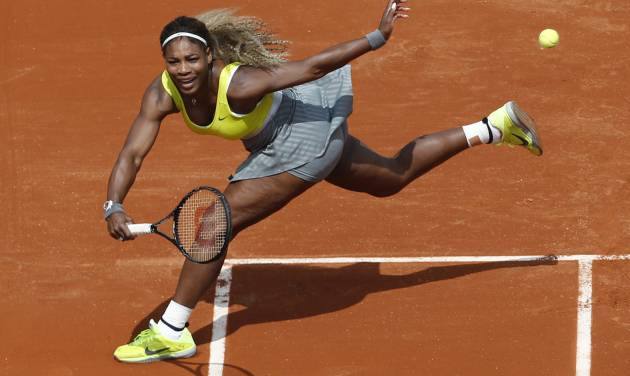 Serena Williams of the U.S. returns the ball during the first round match of the French Open tennis tournament against France's Alize Lim at the Roland Garros stadium, in Paris, France, Sunday, May 25, 2014. (AP Photo/Darko Vojinovic)
