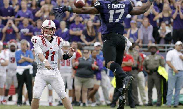 TCU safety Sam Carter (17) is unable to block SMU quarterback Garrett Gilbert's (11) touchdonw pass to wide receiver Darius Joseph (18) during the second half of an NCAA college football game Saturday, Sept. 28, 2013, in Fort Worth, Texas. TCU won 48-17.(AP Photo/Brandon Wade)