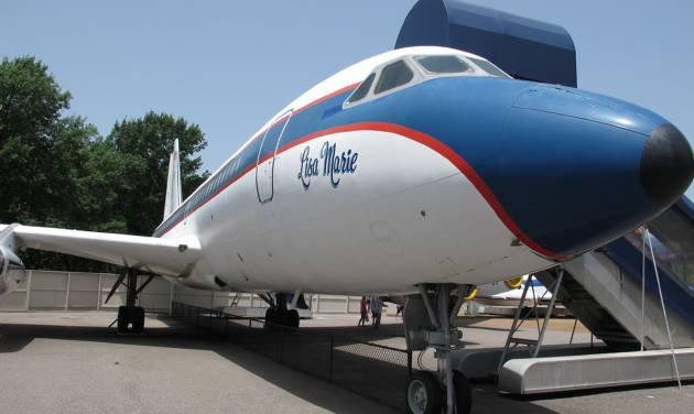 """FILE - This Tuesday, July 1, 2014, file photo shows the Lisa Marie, one of two jets once owned by late singer Elvis Presley, which is part of the Graceland tourist attraction in Memphis, Tenn. Priscilla Presley is asking fans of her late ex-husband Elvis Presley to """"please calm down"""" after a report that the jets could be removed from Graceland. (AP Photo/Adrian Sainz, File)"""