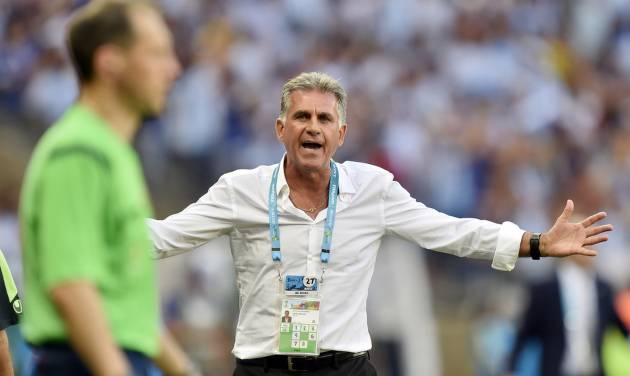 Iran's head coach Carlos Queiroz questions a linesman on a call during the group F World Cup soccer match between Argentina and Iran at the Mineirao Stadium in Belo Horizonte, Brazil, Saturday, June 21, 2014. Argentina defeated Iran 1-0. (AP Photo/Martin Meissner)