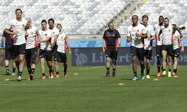Belgium head coach Marc Wilmots walks between his players during a training session at the Mineirao Stadium in Belo Horizonte, Brazil, Monday, June 16, 2014.  Belgium will play in group H of the Brazil 2014 soccer World Cup.  (AP Photo/Bruno Magalhaes)